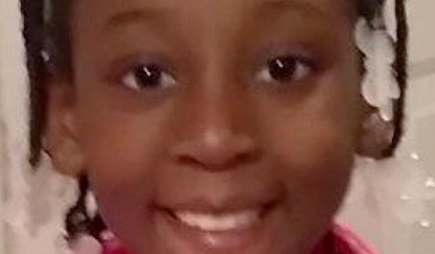 This photo provided by the Los Angeles County Sheriff's Office shows 9-year-old Trinity Love Jones, who was found dead in a duffel bag along a suburban Los Angeles equestrian trail on March 5, 2019. The coroner's office has determined that her death was a homicide. Investigators have detained two people in connection with the case and are seeking help from the public for any additional information. (Los Angeles County Sheriff's Office via AP)