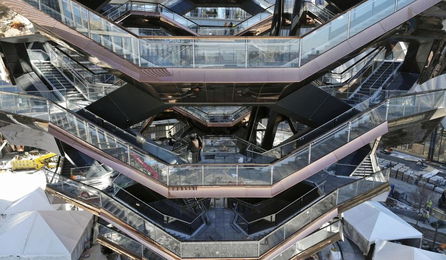 "This March 5, 2019, photo taken with a drone shows ""Vessel,"" a 150-foot-tall structure of climbable interlocking staircases, that is the center point of the $25 billion Hudson Yards Redevelopment in New York. The climbable structure opens to the public on Friday. (AP Photo/Ted Shaffrey)"