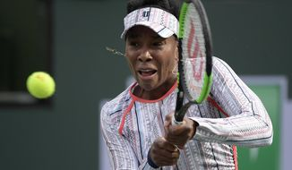 Venus Williams returns a shot to Christina McHale at the BNP Paribas Open tennis tournament Monday, March 11, 2019, in Indian Wells, Calif. (AP Photo/Mark J. Terrill)