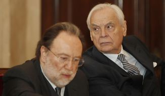 La Scala theater general manager Alexander Pereira, right, and La Scala conductor Riccardo Chailly attend a press conference, in Milan, Italy, Monday, March 11, 2019. Italy's premier opera house, La Scala in Milan, is under fire over a proposal to grant a board seat to Saudi Arabia's culture minister with the promise of 15 million euros ($16.8 million) in new funding. (AP Photo/Antonio Calanni)