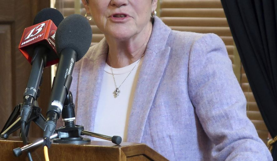 """FILE--In this Thursday, March 7, 2019,file photo, Kansas Gov. Laura Kelly answers questions during a news conference on Medicaid expansion at the Statehouse in Topeka, Kansas. Kelly's expansion plan dilutes a """"poison pill"""" that has been included in past proposals to end the expansion if the federal government backs off its promises to cover most of the cost. (AP Photo/John Hanna, File)"""
