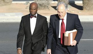 Former Nevada Senate Majority Leader Kelvin Atkinson, left, and his attorney Richard Wright arrive at the Lloyd George U.S. Courthouse on Monday, March 11, 2019, in Las Vegas. Atkinson pleaded guilty to wire fraud after admitting to taking about $250,000 in campaign funds to lease a luxury SUV, open a Las Vegas night club and other personal expenses.  (Bizuayehu Tesfaye/Las Vegas Review-Journal via AP)