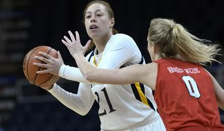 Quinnipiac forward Jen Fay (21) is defended by Marist guard Grace Vander Weide (0) during the first half of an NCAA college basketball game in the Metro Atlantic Athletic Conference women's tournament, Monday, March 11, 2019, in Albany, N.Y. (AP Photo/Hans Pennink)