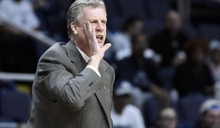 Iona head coach Tim Cluess shouts instructions to his players during the first half of the championship NCAA college basketball game against Monmouth in the Metro Atlantic Athletic Conference tournament, Monday, March 11, 2019, in Albany, N.Y. (AP Photo/Hans Pennink)