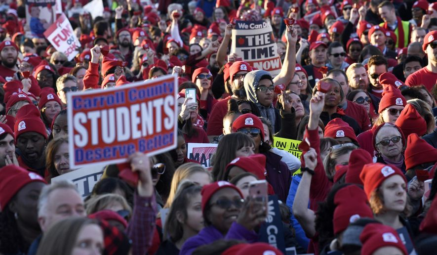 Hundreds of teachers, parents and students participate in a rally near the state capital in Annapolis in Md., Monday, March 11, 2019. Maryland's largest union says it expected thousands of teachers to march on the state capital in a call for increased school funding. (AP Photo/Susan Walsh)