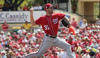 Washington Nationals starting pitcher Max Scherzer (31) delivers in the first inning during an exhibition spring training baseball game agains the St. Louis Cardinals on Monday, March 11, 2019, in Jupiter, Fla. (AP Photo/Brynn Anderson)