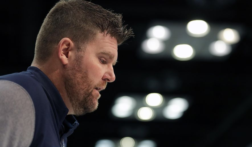 Tennessee Titans general manager Jon Robinson speaks during a press conference at the NFL football scouting combine in Indianapolis, Wednesday, Feb. 27, 2019. (AP Photo/Michael Conroy)