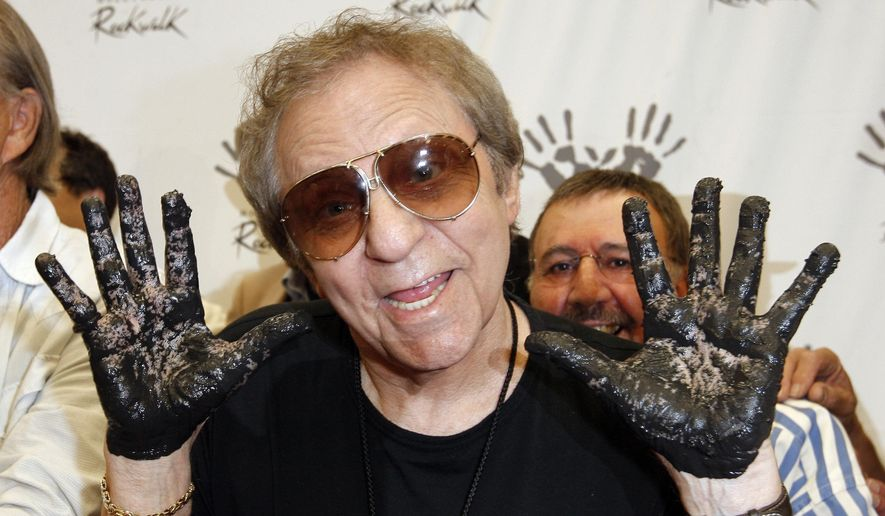 In this June 25, 2008, file photo, Hal Blaine holds up his hands covered in cement after placing them in wet cement with Don Randi and Glen Campbell, representing The Wrecking Crew following an induction ceremony for Hollywood's RockWalk in Los Angeles. Drummer Blaine, who played on many of the biggest hits in music history, has died. Blaine's son-in-law Andy Johnson tells The Associated Press that Blaine died of natural causes Monday, March 11, 2019, at his home in Palm Desert, California. He was 90. (AP Photo/Kevork Djansezian, File)