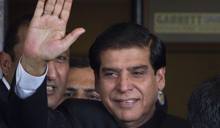 FILE - In this Aug. 27, 2012 file photo, Pakistan's former Prime Minister Raja Pervaiz Ashraf waves in Islamabad, Pakistan. On Monday, March 11, 2019, a Pakistani anti-graft tribunal indicted Ashraf and six others over charges of causing millions of dollar loss to national exchequer because of delay in executing a power project. (AP Photo/Anjum Naveed, File)
