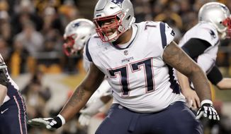 FILE - In this Dec. 16, 2018, file photo, New England Patriots offensive tackle Trent Brown (77) plays against the Pittsburgh Steelers in an NFL football game,in Pittsburgh. The Oakland Raiders have agreed to sign free agent offensive tackle Trent Brown to a four-year deal worth a record $66 million. A person familiar with the contract said Monday, March 11, 2019, that Brown will receive $36.75 million guaranteed in the richest contract ever for an offensive lineman. The person spoke on condition of anonymity because the deal can't be finalized until the new league year starts Wednesday. (AP Photo/Don Wright, File)