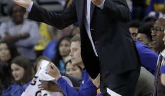 Golden State Warriors head coach Steve Kerr gestures toward officials during the second half of his team's NBA basketball game against the Phoenix Suns in Oakland, Calif., Sunday, March 10, 2019. (AP Photo/Jeff Chiu)