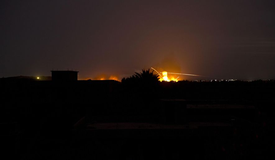 Tracer fire and explosions lights up the night sky as U.S.-backed Syrian Democratic Forces (SDF) fire on Baghouz, Syria, Sunday, March 10, 2019. (AP Photo/Maya Alleruzzo)
