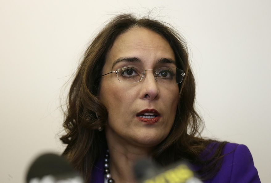 Attorney Harmeet Dhillon speaks during a news conference in San Francisco. Five California educators filed a lawsuit Monday, March, 11, 2019, seeking to stop the state's top teachers union from collecting dues through mandatory paycheck deductions, the latest in a series of similar legal challenges filed across the country. (AP Photo/Eric Risberg, File)