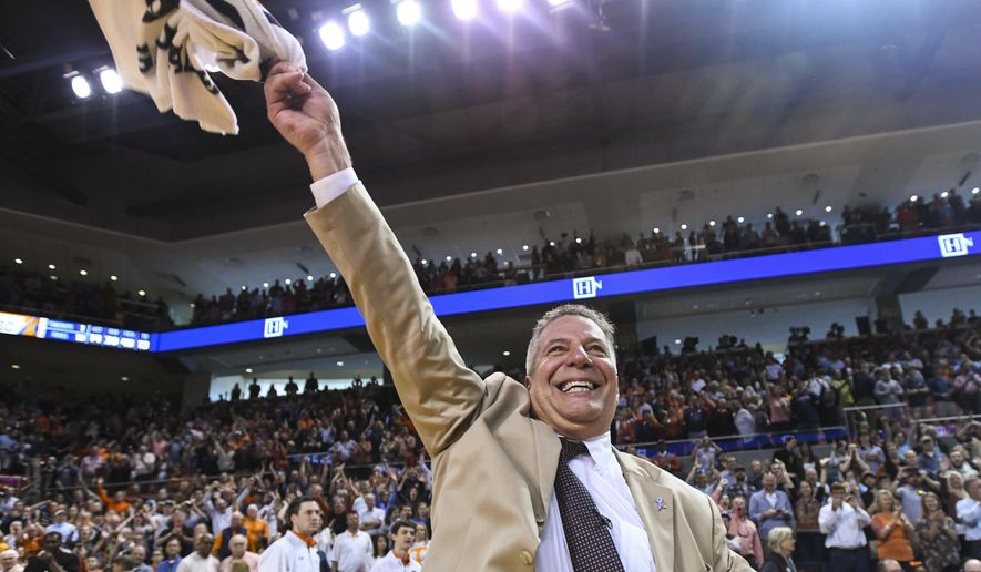 Auburn head coach Bruce Pearl celebrates his 84-80 win over Tennessee after an NCAA college basketball game Saturday, March 9, 2019, in Auburn, Ala. (AP Photo/Julie Bennett)