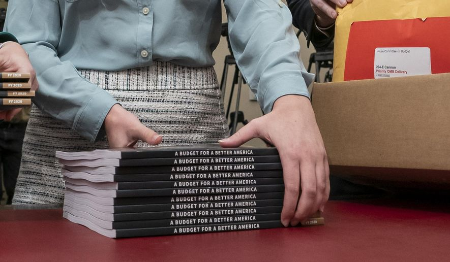 Office of Management and Budget staff delivers President Donald Trump's 2020 budget outline to the House Budget Committee on Capitol Hill in Washington, Monday, March 11, 2019. Trump's new budget calls for billions more for his border wall, with steep cuts in domestic programs but increases for military spending. (AP Photo/J. Scott Applewhite)