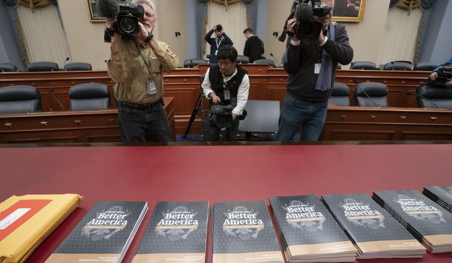 President Donald Trump's 2020 budget outline arrives on Capitol Hill at the House Budget Committee, in Washington, Monday morning March 11, 2019. Trump's new budget calls for billions more for his border wall, with steep cuts in domestic programs but increases for military spending. (AP Photo/J. Scott Applewhite)