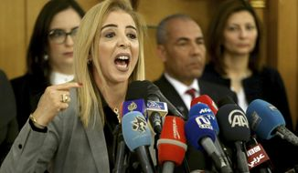 New interim Tunisia's Health Minister Sonia Ben Sheikh gives press conference in Tunis, Monday, March 11, 2019. Tunisia's interim health minister says 12 newborn babies have died after receiving treatment in a state maternity hospital amid a brewing scandal that led to the resignation of Health Minister Abderraouf Cherif this weekend. (AP Photo/Hassene Dridi)