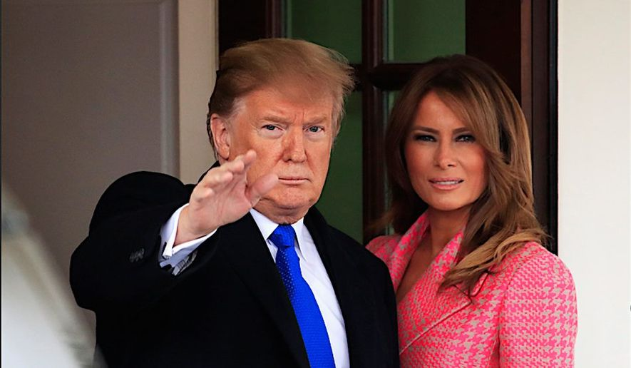 President Trump with first lady Melania Trump take a moment to wave, just outside the West Wing of the White House. (Associated Press)