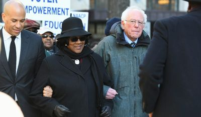 Sen. Bernard Sanders is campaigning early in South Carolina, particularly among black voters who make up a major part of the base of the Democratic Party. Sen. Cory A. Booker, (left), is also putting an early focus on black voters in South Carolina. Mr. Sanders lost the state in 2016 by 47 percentage points. (Associated Press photographs)