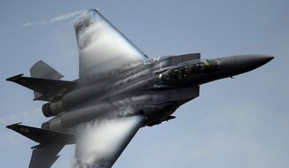 F-15E Strike Eagle from Seymour Johnson AFB N.C., demonstrates its maneuverability at the Charleston Air Expo, Joint Base Charleston S.C., April 9, 2011.  The F-15E is a multirole fighter capable of air to surface and air to air combat.  (U.S. Air Force photo by Airman 1st Class James Richardson/Released) ** FILE **
