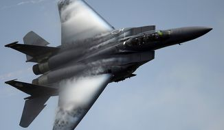 F-15E Strike Eagle from Seymour Johnson AFB N.C., demonstrates its maneuverability at the Charleston Air Expo, Joint Base Charleston S.C., April 9, 2011.  The F-15E is a multirole fighter capable of air to surface and air to air combat.  (U.S. Air Force photo by Airman 1st Class James Richardson/Released)