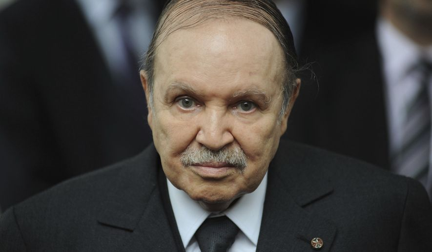 In this Nov. 21, 2011, file photo, Algerian President Abdelaziz Bouteflika waits for Rachid Ghannouchi, head of the Tunisian party Ennahdha, in Algiers. Algeria's longtime leader Abdelaziz Bouteflika has been known as a wily political survivor ever since he fought for independence from France in the 1960s, and now he needs to overcome mass protests against his rule. (AP Photo/Sidali Djarboub, File)
