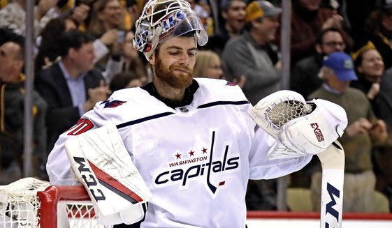 Washington Capitals goaltender Braden Holtby collects himself after allowing a goal by Pittsburgh Penguins' Sidney Crosby in the second period of an NHL hockey game in Pittsburgh, Tuesday, March 12, 2019. The Penguins won 5-3. (AP Photo/Gene J. Puskar) ** FILE **