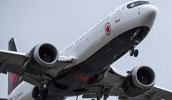 "An Air Canada Boeing 737 Max 8 aircraft arriving from Toronto prepares to land at Vancouver International Airport, in Richmond, British Columbia on Tuesday, March 12, 2019. Canadian Transport Minister Marc Garneau says ""all options are on the table"" with regard to the country's fleet of Boeing 737 Max 8 aircraft but says the government currently has no plans to order the grounding of the plane. (Darryl Dyck/The Canadian Press via AP)"