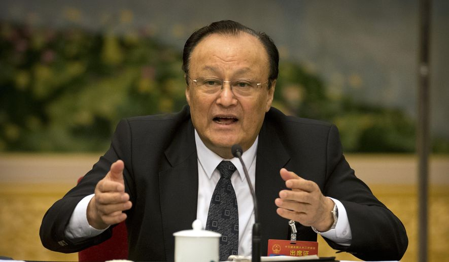 "Shohrat Zakir, chairman of China's Xinjiang Uighur Autonomous Region, speaks during a group discussion meeting on the sidelines of China's National People's Congress (NPC) at the Great Hall of the People in Beijing, Tuesday, March 12, 2019. China says heavily guarded internment camps for Muslims, which it calls vocational training centers, will ""gradually disappear"" if there comes a day that ""society does not need"" them. (AP Photo/Mark Schiefelbein)"