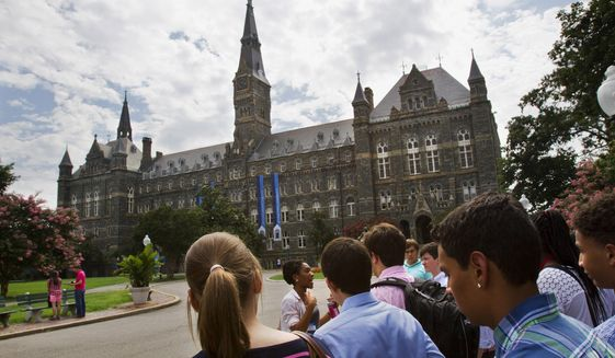 FILE - In this July 10, 2013, file photo, prospective students tour Georgetown University's campus in Washington. Federal authorities have charged college coaches and others in a sweeping admissions bribery case in federal court. The racketeering conspiracy charges were unsealed Tuesday, March 12, 2019, against the coaches at schools including Georgetown, Wake Forest University and the University of Southern California. Authorities say the coaches accepted bribes in exchange for admitting students as athletes, regardless of their ability. (AP Photo/Jacquelyn Martin) ** FILE **
