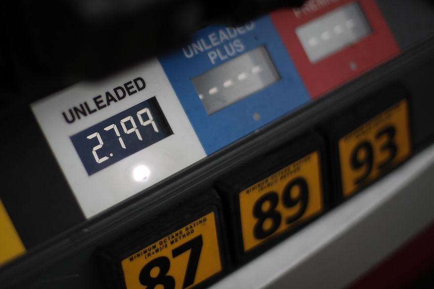 FILE- This Nov. 16, 2018, file photo shows gas prices at a pump in West Mifflin, Pa. On Tuesday, March 12, 2019, the Labor Department reports on U.S. consumer prices for February. (AP Photo/Gene J. Puskar, File)