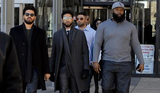 "Empire actor Jussie Smollett, center, leaves the Leighton Criminal Court Building after a hearing on Tuesday, March 12, 2019, in Chicago. A lawyer for Smollett said Tuesday that she would welcome cameras in the courtroom during the ""Empire"" actor's trial on charges accusing him of lying to police, saying there has been a lot of leaked misinformation and that cameras would allow the public to ""see the evidence and the lack thereof."" (AP Photo/Matt Marton)"