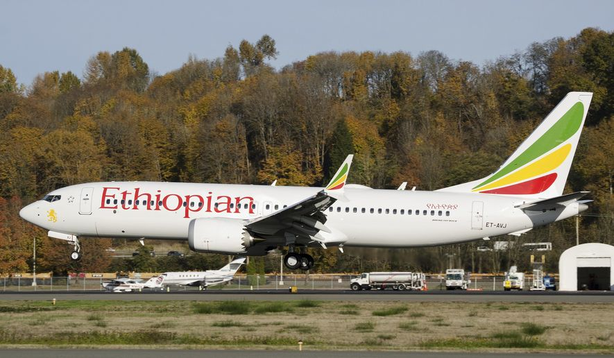 In this photo dated November 12, 2018, the actual Ethiopian Airlines Boeing 737 - Max 8 plane, that crashed Sunday, March 10, 2019, shortly after take-off from Addis Ababa, Ethiopia, shown as it lands at Seattle Boeing Field King County International airport, USA. U.S. aviation experts on Tuesday, March 12, 2019, joined the investigation into the crash of this Ethiopian Airlines jetliner that killed 157 people, as questions grow about the new Boeing plane involved in the crash. (AP Photo/Preston Fiedler)