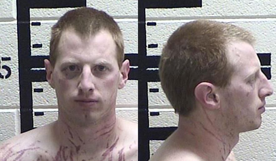 This March 2019 booking photo provided by Murray County Sheriff's Department shows Kirk Taylor Martin. Martin, a former jail guard in Georgia, was arrested and faces rape and other charges after police say he held a woman in her home. The Georgia Bureau of Investigation said in a news release that Martin, of Acworth, Ga., is also charged with aggravated sexual battery, aggravated assault, criminal attempt to commit sodomy, false imprisonment and obstructing an emergency call. (Murray County Sheriff's Department via A)