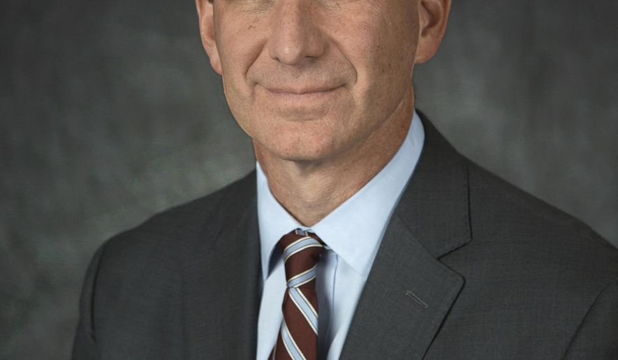 This 2018 photo made available by the National Cancer Institute shows Dr. Norman E. Sharpless. On Tuesday, March 12, 2019, The Food and Drug Administration announced that Sharpless will temporarily take charge of the agency after the unexpected departure of its current chief, Scott Gottlieb. (H. Darr Beiser/NCI via AP)