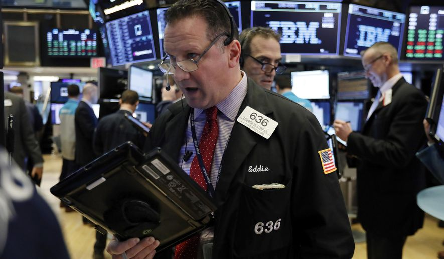 FILE- In this March 5, 2019, file photo trader Edward Curran, left, works on the floor of the New York Stock Exchange. The U.S. stock market opens at 9:30 a.m. EDT on Tuesday, March 12. (AP Photo/Richard Drew, File)