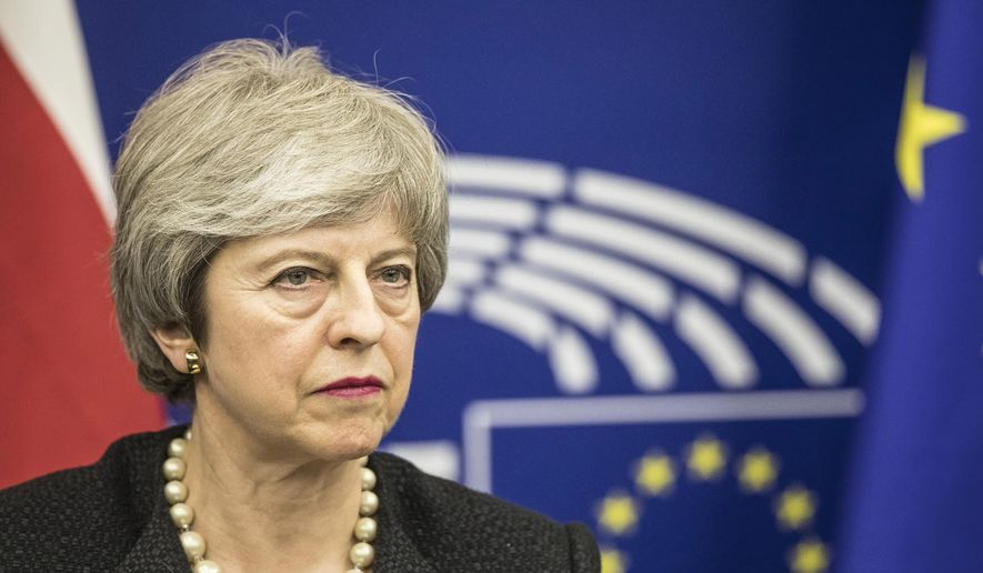 Britain's Prime Minister Theresa May, speaks during a media conference after a meeting with European Commission President Jean-Claude Juncker at the European Parliament in Strasbourg, eastern France, Monday, March 11, 2019. Prime Minister Theresa May is making a last-ditch attempt to get concessions from EU counterparts on elements of the agreement they all reached late last year. (AP Photo/Jean-Francois Badias)