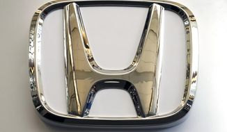 In this Feb. 14, 2019, photo, this photo shows the Honda logo on a sign at the 2019 Pittsburgh International Auto Show in Pittsburgh. Honda will be recalling about 1 million older vehicles in the U.S. and Canada because the Takata driver's air bag inflators that were installed during previous recalls could be dangerous. Documents posted Monday, March 11, 2019, by Canadian safety regulators show that Honda is recalling many of its most popular models for a second time. (AP Photo/Gene J. Puskar)