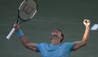Philipp Kohlschreiber, of Germany, reacts after defeating Novak Djokovic, of Serbia, at the BNP Paribas Open tennis tournament Tuesday, March 12, 2019 in Indian Wells, Calif. (AP Photo/Mark J. Terrill)