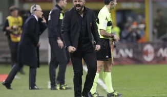 AC Milan coach Gennaro Gattuso celebrates his side's 1-0 win at the end of the Serie A soccer match between AC Milan and Sassuolo, at the San Siro stadium in Milan, Italy, Saturday, March 2, 2019. (AP Photo/Luca Bruno)