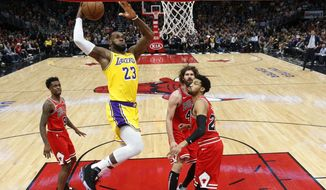 Los Angeles Lakers forward LeBron James (23) goes for a dunk against the against the Chicago Bulls during the second half of an NBA basketball game Tuesday, March 12, 2019, in Chicago. (AP Photo/Nuccio DiNuzzo)