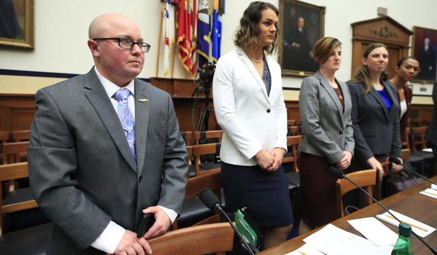 FILE - In this Feb. 27, 2019, file photo, from left, transgender military members Navy Lt. Cmdr. Blake Dremann, Army Capt. Alivia Stehlik, Army Capt. Jennifer Peace, Army Staff Sgt. Patricia King and Navy Petty Officer Third Class Akira Wyatt, listen before the start of a House Armed Services Subcommittee on Military Personnel hearing on Capitol Hill in Washington. The Defense Department has approved a new policy that will largely bar transgender troops and military recruits from transitioning to another sex, and require most individuals to serve in their birth gender. (AP Photo/Manuel Balce Ceneta, File)