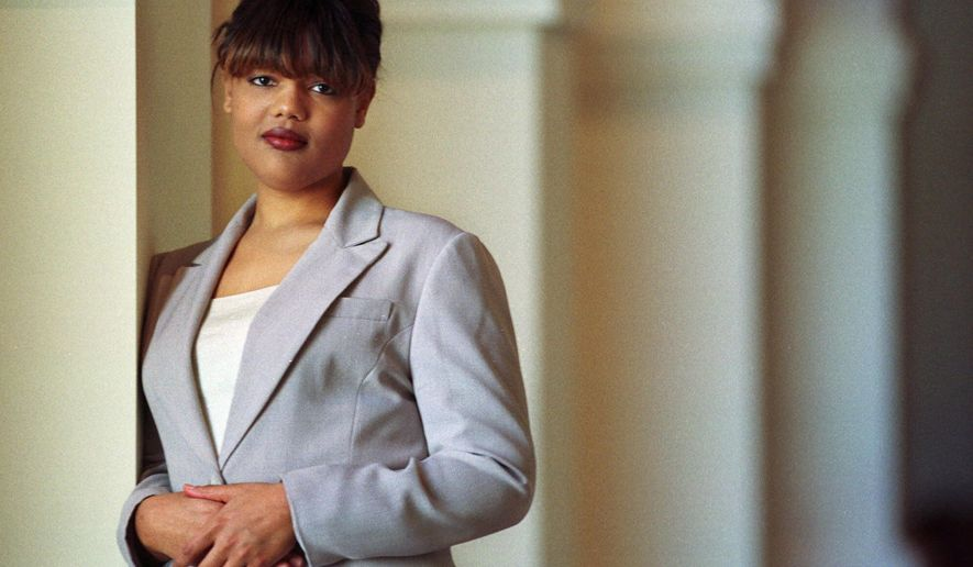 FILE - In this Feb. 10, 2000, file photo, Freeda Foreman stands in The Regent Las Vegas Hotel and Casino in Las Vegas, following a press conference announcing her professional boxing debut. The 42-year-old daughter of former heavyweight champion George Foreman died at a Houston-area home. The Harris County sheriff's office said deputies were called Friday, March 8, 2019, to the home where EMS had determined Freeda George Foreman was dead. (AP Photo/Laura Rauch, File)