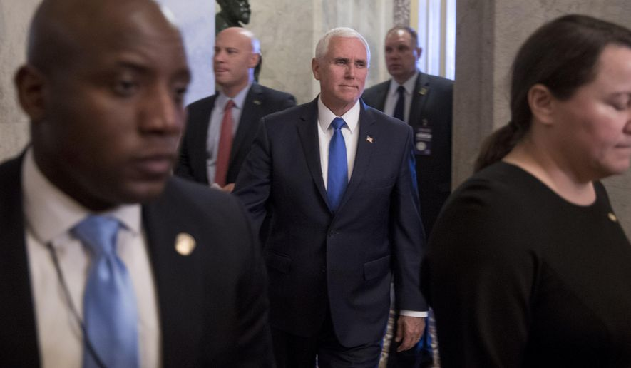 Vice President Mike Pence, center, accompanied by his Chief of Staff Marc Short, second from left, leaves the U.S. Capitol building on Capitol Hill in Washington, Tuesday, March 12, 2019. (AP Photo/Andrew Harnik)