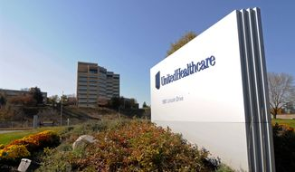 This Oct. 16, 2012, file photo, shows a portion of the UnitedHealth Group Inc.'s campus in Minnetonka, Minn. The nation's biggest health insurer is expanding a program that passes rebates from drugmakers directly to the people that use their medications. UnitedHealthcare said Tuesday, March 12, 2019, that next year, all of its new, employer-sponsored healthcare plans must give point-of-sale discounts to consumers when they pick up medications.  (AP Photo/Jim Mone, File)
