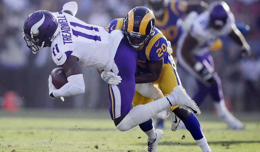 FILE - In this Sept. 27, 2018, file photo, Minnesota Vikings wide receiver Laquon Treadwell (11) is tackled by Los Angeles Rams defensive back Lamarcus Joyner during the first half in an NFL football game in Los Angeles.  The Oakland Raiders have agreed to a four-year contract with free agent safety Lamarcus Joyner. A person familiar with the deal said Tuesday, March 12, 2019, on condition of anonymity, that Joyner will sign the contract after the start of the new league year. The person spoke on condition of anonymity because the move can't be finalized until Wednesday. (AP Photo/Jae C. Hong, File)