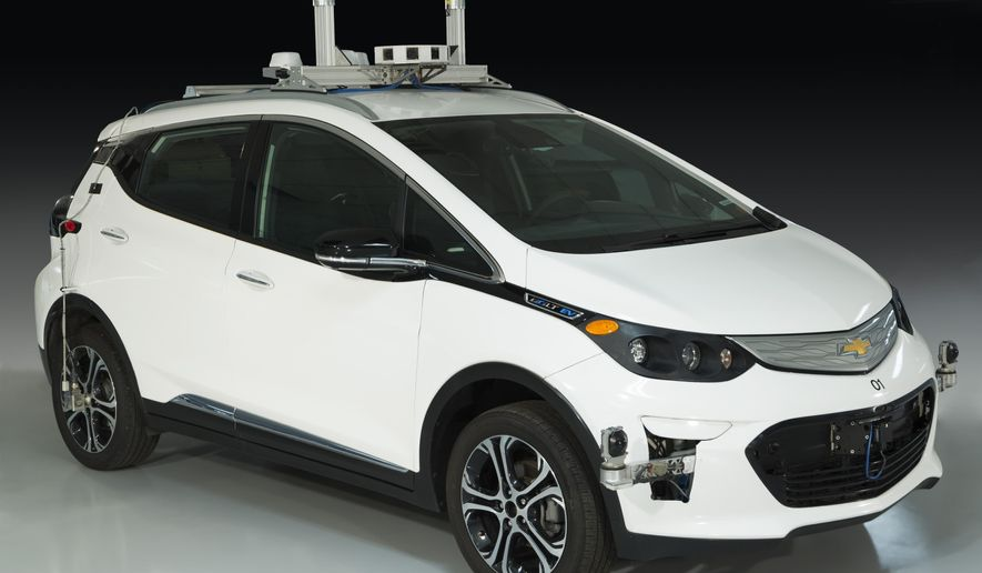 """In a photo provided by The Henry Ford Museum, a Chevrolet Bolt, one of General Motors' first self-driving test vehicles is shown. The Henry Ford announced Tuesday, March 12, 2019, that the modified pre-production Bolt electric vehicle, which originally made its debut in 2016, is the first autonomous car to be added to its collection. The vehicle will be displayed at the """"Driving America"""" exhibit that chronicles the history of the automobile at the Henry Ford Museum of American Innovation. (Rudy Ruzicska/The Henry Ford via AP)"""