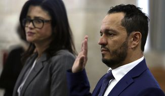 Albert Alvarez takes the oath before testifying at the joint legislative oversight committee, Tuesday March 12, 2019 in Trenton, NJ. Alvarez, a former Murphy administration official accused of sexual assault but not criminally charged discussed the administration's hiring practices during the hearing. A key unanswered question after months of legislative hearings is who hired Alvarez at the schools authority. (AP Photo/Jacqueline Larma)