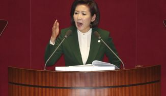 """Na Kyung-won, the floor leader of the main opposition Liberty Korea Party, delivers a speech at the National Assembly in Seoul, South Korea, Tuesday, March 12, 2019. The office of South Korean President Moon Jae-in has responded sharply to comments by the conservative lawmaker who accused him of acting as the """"top spokesman"""" of North Korean leader Kim Jong Un. (Kim Hyun-tai/Yonhap via AP)"""