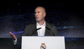 Newly appointed Real Madrid head coach Zinedine Zidane speaks during a press conference in Madrid, Monday March 11, 2019. Real Madrid picked one of its most successful coaches to try to end one of its worst crises. Zidane is returning to coach Real Madrid, the club he led to three straight Champions League titles. (AP Photo/Bernat Armangue)